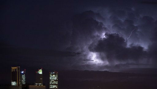 An electrical storm lights up the night sky behind the business district in Madrid, Spain, Wednesday, Oct. 10, 2012. &#40;AP Photo&#47;Alberto Di Lolli&#41; <span class=meta>(AP Photo&#47; Alberto Di Lolli)</span>