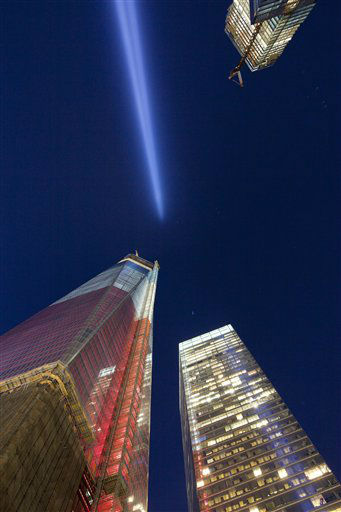 The Tribute in Light shines above 1 World Trade Center, left, and 7 World Trade Center, Tuesday, Sept. 11, 2012 in New York. Today marks the 11th anniversary of the terrorist attacks of Sept. 11, 2001. &#40;AP Photo&#47;Mark Lennihan&#41; <span class=meta>(AP Photo&#47; Mark Lennihan)</span>