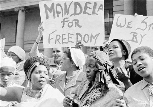 African women join in a demonstration in South Africa, Aug. 16, 1962, demanding the release of Nelson Mandela, former secretary of the banned African National Congress, who appeared in court on a charge of incitement.  The women, together with Winnie Mandela chanted &#34;down with Verwoerd on the steps of the Johannesburg City Hall. &#40;AP Photo&#47;Dennis Lee Royle&#41; <span class=meta>(AP Photo&#47; Dennis Lee Royle)</span>