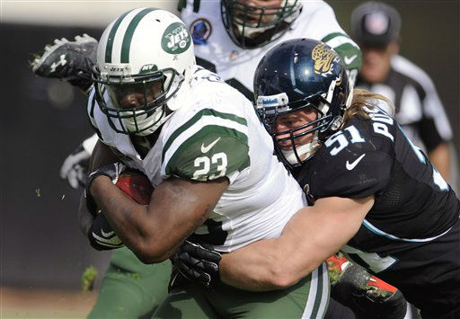 New York Jets running back Shonn Greene &#40;23&#41; is tackled by Jacksonville Jaguars middle linebacker Paul Posluszny &#40;51&#41; after a short gain during the first half of an NFL football game, Sunday, Dec. 9, 2012, in Jacksonville, Fla. &#40;AP Photo&#47;Stephen Morton&#41; <span class=meta>(AP Photo&#47; Stephen Morton)</span>