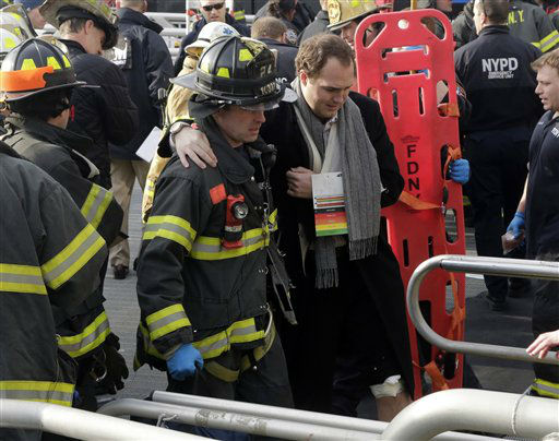 An injured passenger from the Seastreak Wall Street ferry is taken to an ambulance, in New York,  Wednesday, Jan. 9, 2013. The  ferry from Atlantic Highlands, N.J., banged into the mooring as it arrived at South Street in lower Manhattan during morning rush hour, injuring as many as 50 people, at least one critically, officials said.&#40;AP Photo&#47;Richard Drew&#41; <span class=meta>(AP Photo&#47; Richard Drew)</span>