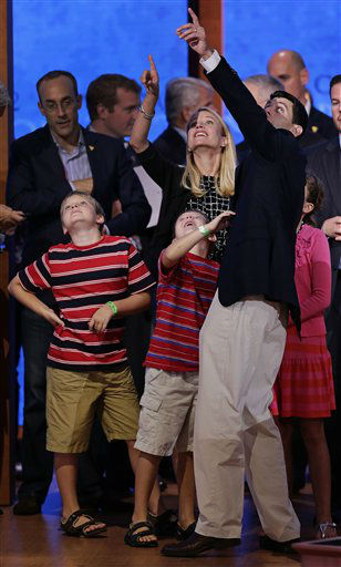 Republican vice presidential nominee, Rep. Paul Ryan of Wisconsin points out the balloons with his wife Janna to their children, &#40;L-R&#41;, Charlie, Sam and Liza during a podium sound check at the Republican National Convention in Tampa, Fla., on Wednesday, Aug. 29, 2012. &#40;AP Photo&#47;J. Scott Applewhite&#41; <span class=meta>(AP Photo&#47; J. Scott Applewhite)</span>