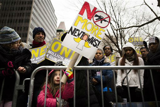 Emma Clyman, 5, of Manhattan, holds a sign that reads &#34;No More Newtowns&#34; outside city hall park during the One Million Moms for Gun Control Rally, Jan. 21, 2012, in New York. Demonstrators called for new gun control legislation, demanding a ban on assault weapons and stricter regulations on gun purchases. &#40;AP Photo&#47;John Minchillo&#41; <span class=meta>(AP Photo&#47; John Minchillo)</span>