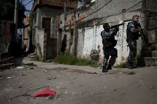 Military police patrol the Complexo do Alemao slum in Rio de Janeiro, Brazil, Tuesday, July 24, 2012. Public safety authorities say a police officer was shot and killed in this hillside &#34;favela&#34; slum that&#39;s a key symbol of the Olympic city&#39;s highly publicized slum pacification program. &#40;AP Photo&#47;Felipe Dana&#41; <span class=meta>(AP Photo&#47; Felipe Dana)</span>