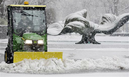 Kevin Quick plows a slushy mix in front of M &amp; T Bank during a winter storm in Buffalo, N.Y., Friday, Feb. 8, 2013. In some upstate areas, snow fell early Friday morning and was expected to increase throughout the day, with the heaviest accumulations expected in eastern New York on Friday night.&#40;AP Photo&#47;David Duprey&#41; <span class=meta>(Photo&#47;David Duprey)</span>