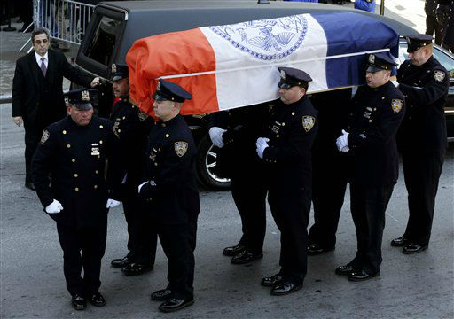 "<div class=""meta image-caption""><div class=""origin-logo origin-image ""><span></span></div><span class=""caption-text"">A casket containing the remains of former New York City Mayor Ed Koch is brought into Temple Emanu-El, at for his funeral in New York, Monday, Feb. 4, 2013. The crowd braved temperatures in the low 20s and a fierce wind while waiting in two lines outside the temple. Koch died Friday, Feb. 1, 2013. (AP Photo/Seth Wenig) (AP Photo/ Seth Wenig)</span></div>"