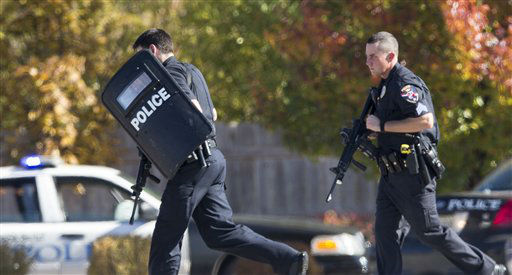 Police and swat team members respond to a call of a shooting at the Azana Spa in Brookfield, Wis.  Sunday,Oct. 21, 2012.  Multiple people were wounded when someone opened fire at the spa near the Brookfield Square Mall. Deputies are still looking for the gunman. &#40;AP Photo&#47;Tom Lynn&#41; <span class=meta>(AP Photo&#47; Tom Lynn)</span>