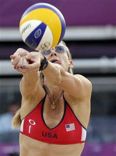Kerri Walsh of the United States sets the ball during a beach volleyball match against Italy at the 2012 Summer Olympics, Sunday, Aug. 5, 2012, in London. &#40;AP Photo&#47;Dave Martin&#41; <span class=meta>(AP Photo&#47; Dave Martin)</span>