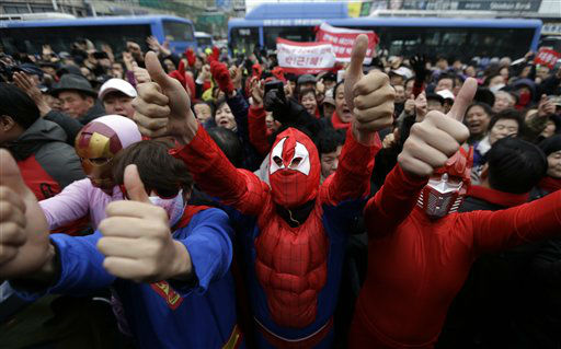 Supporters of South Korea&#39;s presidential candidate Park Geun-hye of ruling Saenuri Party in costumes give thumbs-up signs during her presidential election campaign in Seoul, South Korea, Friday, Dec. 7, 2012. South Korea&#39;s presidential election is scheduled for Dec. 19. &#40;AP Photo&#47;Lee Jin-man&#41; <span class=meta>(AP Photo&#47; Lee Jin-man)</span>