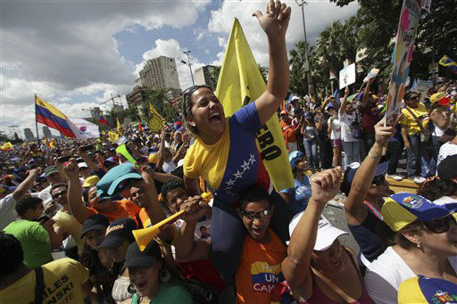 Supporters of opposition Presidential candidate Henrique Capriles cheer during a campaign rally in Caracas, Venezuela, Sunday, Sept. 30, 2012. Presidential elections in Venezuela are scheduled for Oct. 7.&#40;AP Photo&#47;Fernando Llano&#41; <span class=meta>(AP Photo&#47; Fernando Llano)</span>