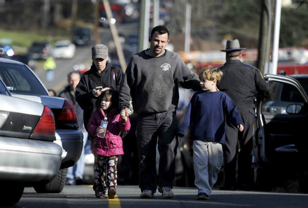 Parents leave a staging area after being reunited with their children following a shooting at the Sandy Hook Elementary School in Newtown, Conn., about 60 miles &#40;96 kilometers&#41; northeast of New York City, Friday, Dec. 14, 2012. An official with knowledge of Friday&#39;s shooting said 27 people were dead, including 18 children. It was the worst school shooting in the country&#39;s history. &#40;AP Photo&#47;Jessica Hill&#41; <span class=meta>(AP Photo&#47; Jessica Hill)</span>