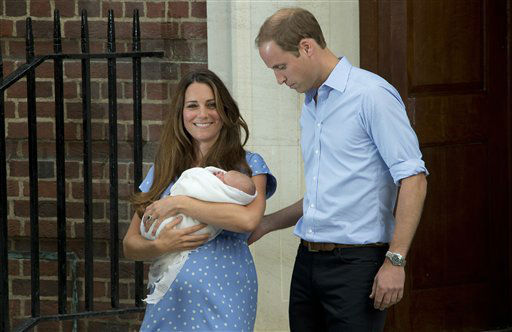 "<div class=""meta ""><span class=""caption-text "">Britain's Prince William, right, and Kate, Duchess of Cambridge hold the Prince of Cambridge, Tuesday July 23, 2013, as they pose for photographers outside St. Mary's Hospital exclusive Lindo Wing in London where the Duchess gave birth on Monday July 22. The Royal couple are expected to head to London?s Kensington Palace from the hospital with their newly born son, the third in line to the British throne. (Photo by Joel Ryan/Invision/AP) (Photo/Joel Ryan)</span></div>"