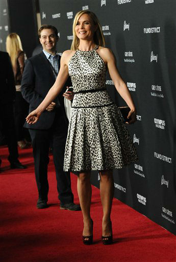 "Radha Mitchell arrives at the LA premiere of ""Olympus Has Fallen"" at the ArcLight Theatre on Monday, March 18, 2013 in Los Angeles. (Photo by Jordan Strauss/Invision/AP)"