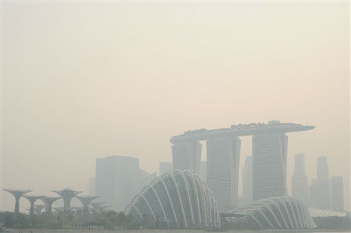 "<div class=""meta image-caption""><div class=""origin-logo origin-image ""><span></span></div><span class=""caption-text"">The Singapore skyline is shrouded in haze Friday, June 21, 2013. Air pollution in Singapore soared to record heights for a third consecutive day, as Indonesia dispatched planes and helicopters Friday to battle raging fires blamed for hazardous levels of smoky haze in three countries. (AP Photo/Joseph Nair) (AP Photo/ Joseph Nair)</span></div>"