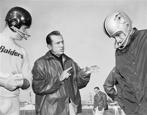 Al Davis, head coach of the American Football League?s Oakland Raiders, has been named ?Coach of the Year.? He is shown as he talked, Dec. 18, 1963 in Oakland with his players at the team?s home practice field. &#40;AP Photo&#47;Robert Klein&#41; <span class=meta>(AP Photo&#47; Robert Klein)</span>