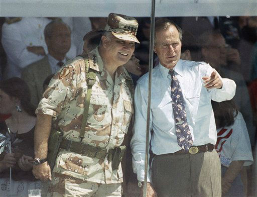 FILE - In this June 8, 1991 file photo, Gen. Norman Schwarzkopf and President George Bush watch the National Victory Parade from the viewing stand in Washington. Schwarzkopf led his troops in the parade, and then joined Bush in the reviewing stand.  Schwarzkopf died Thursday, Dec. 27, 2012 in Tampa, Fla. He was 78. &#40;AP Photo&#47;Ron Edmonds, File&#41; <span class=meta>(AP Photo&#47; Ron Edmonds)</span>