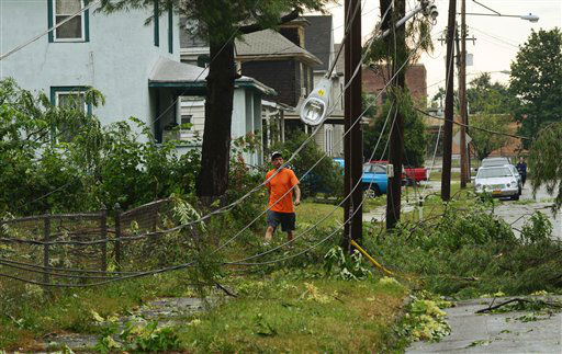 A man walks through the aftermath of a tornado that struck in Elmira, N.Y., Thursday, July 26, 2012. Power lines and trees were toppled and hospitals were placed on disaster alert but there were no immediate reports of injuries after a possible tornado hit the city of Elmira Thursday afternoon, Chemung County Office of Fire and Emergency Management spokeswoman Karen Miner said. &#40;AP Photo&#47;Heather Ainsworth&#41; <span class=meta>(AP Photo&#47; Heather Ainsworth)</span>
