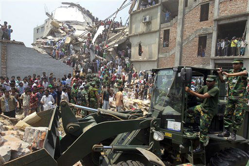 "<div class=""meta image-caption""><div class=""origin-logo origin-image ""><span></span></div><span class=""caption-text"">Bangladeshi soldiers use an earthmover for rescue operations after an eight-story building housing several garment factories collapsed in Savar, near Dhaka, Bangladesh, Wednesday, April 24, 2013. Dozens were killed and many more are feared trapped in the rubble. (AP Photo/ A.M. Ahad) (AP Photo/ A.M. Ahad)</span></div>"