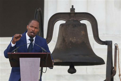 Actor Jamie Foxx speaks at the 50th Anniversary of the March on Washington where Martin Luther King, Jr., spoke, Wednesday, Aug. 28, 2013, at the Lincoln Memorial in Washington. The bell at rear rang at the 16th St Baptist Church in Birmingham, Ala. which was bombed 18 days after the March On Washington killing four young girls. (AP Photo/Charles Dharapak)