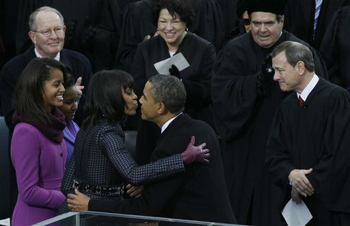 President Barack Obama kisses his wife Michelle after the ceremonial swearing-in at the U.S. Capitol during the 57th Presidential Inauguration in Washington, Monday, Jan. 21, 2013. Right is Chief Justice John Roberts. &#40;AP Photo&#47;Paul Sancya&#41; <span class=meta>(AP Photo&#47; Paul Sancya)</span>