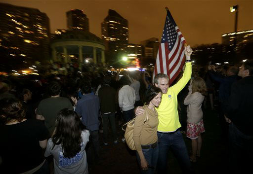Frank McGillin, right, who has ran three Boston Marathons, and his wife, Peggy, pose for a photograph as a crowd reacts to news of the arrest of one of the Boston Marathon bombing suspects during a celebration at Boston Common, Friday, April 19, 2013, in Boston. Boston Marathon bombing suspect Dzhokhar Tsarnaev was captured in Watertown, Mass. The 19-year-old college student wanted in the bombings was taken into custody Friday evening after a manhunt that left the city virtually paralyzed and his older brother and accomplice dead. &#40;AP Photo&#47;Julio Cortez&#41; <span class=meta>(AP Photo&#47; Julio Cortez)</span>