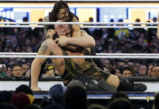 Leati Joseph &#34;Joe&#34; Anoa&#39;i, known as Roman Reigns, top, locks up Paul Randall Wight Jr., known as Big Show, during the WWE Wrestlemania 29 wrestling event, Sunday, April 7, 2013, in East Rutherford, N.J. &#40;AP Photo&#47;Mel Evans&#41; <span class=meta>(AP Photo&#47; Mel Evans)</span>