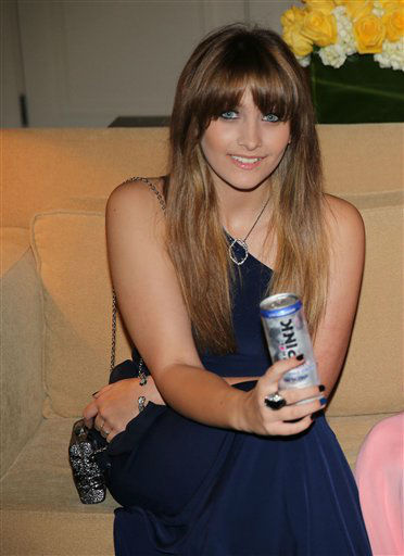 Paris Jackson looking glamorous as she drinks a Mr. Pink Ginseng Drink at the launch party. (PRNewsFoto/Mr. Pink Ginseng Drink)