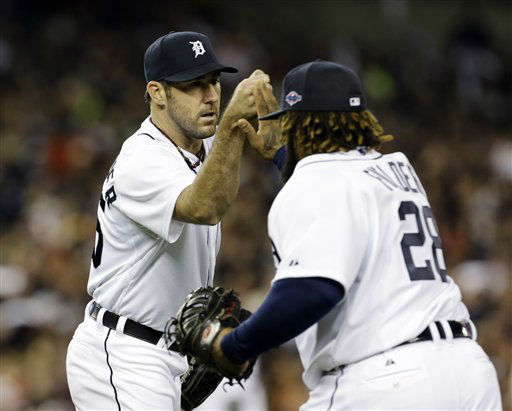 Detroit Tigers&#39; Justin Verlander congratulates first baseman Prince Fielder after New York Yankees&#39; Raul Ibanez grounded out to Fielder in the seventh inning during Game 3 of the American League championship series Tuesday, Oct. 16, 2012, in Detroit. &#40;AP Photo&#47;Paul Sancya &#41; <span class=meta>(AP Photo&#47; Paul Sancya)</span>