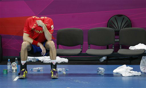 Spain&#39;s Viran Morros de Argila, covers his face after his team lost to France their men&#39;s handball quarterfinal match at the 2012 Summer Olympics, Wednesday, Aug. 8, 2012, in London. &#40;AP Photo&#47;Vadim Ghirda&#41; <span class=meta>(AP Photo&#47; Vadim Ghirda)</span>