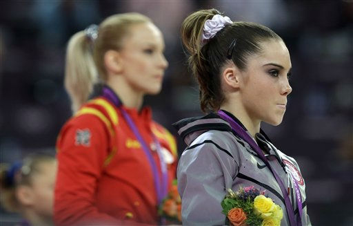 U.S. gymnast McKayla Maroney, right, stand along with Romania&#39;s gymnast Sandra Raluca Izbasa during the podium ceremony for the artistic gymnastics women&#39;s vault finals at the 2012 Summer Olympics, Sunday, Aug. 5, 2012, in London.  &#40;AP Photo&#47;Julie Jacobson&#41; <span class=meta>(AP Photo&#47; Julie Jacobson)</span>