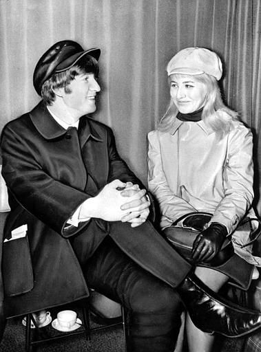 "<div class=""meta ""><span class=""caption-text "">Beatle John Lennon and his wife, Cynthia, sit in London Airport, England, before flying to the U.S. on Feb. 7, 1964.  (AP Photo) (AP Photo/ XNBG)</span></div>"