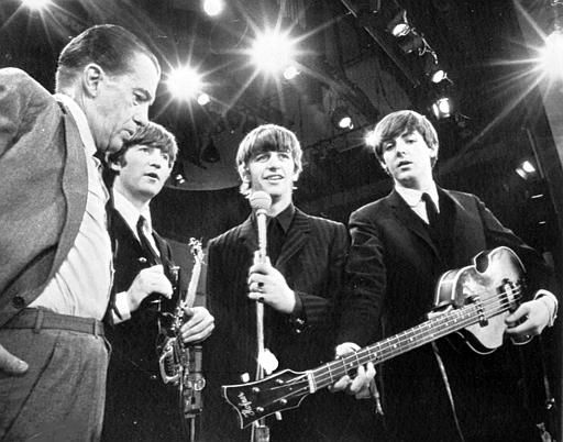 "<div class=""meta ""><span class=""caption-text "">American TV host Ed Sullivan, left, talks with three members of the British pop group The Beatles during a rehearsal for their appearance on his TV show, in New York, Feb. 8, 1964. From left, Sullivan, John Lennon, Ringo Starr and Paul McCartney. George Harrison, the fourth member of the group missed the rehearsal due to illness. (AP Photo) (AP Photo/ XMH)</span></div>"