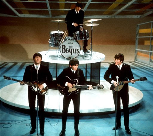** FILE **The Beatles perform on the CBS &#34;Ed Sullivan Show&#34; in New York, in this Feb. 9, 1964, file photo. From left, front, are Paul McCartney, George Harrison and John Lennon. Ringo Starr plays drums in the background. The Beatles&#39; &#34;Love&#34; album is being released on Nov. 21, and is a thorough reinterpretation of their work.  &#40;AP Photo&#47;FILE&#41; <span class=meta>(AP Photo&#47; Anonymous)</span>