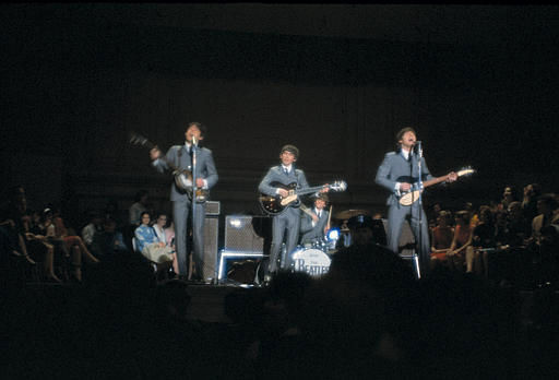 The British rock and roll group the Beatles perform at Carnegie Hall in New York City, Feb. 12, 1964.  From left to right are, Paul McCartney, George Harrison, Ringo Starr, on drums, and John Lennon.  &#40;AP Photo&#41; <span class=meta>(AP Photo&#47; XNBG)</span>