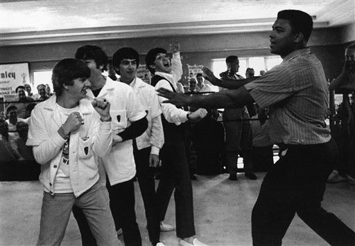 "<div class=""meta ""><span class=""caption-text "">Muhammad Ali, who'll fight heavyweight champ Sonny Liston on February 25, clowns a bit with the Beatles at his training camp in Miami Beach, Florida on Tuesday, Feb. 18, 1964.   The Beatles are, from left: Ringo Starr, John Lennon, George Harrison, and Paul McCartney. (AP Photo) (AP Photo/ JSJ)</span></div>"