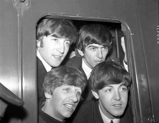 Britain&#39;s pop group The Beatles pose in a carriage window of train before they left Paddington Station, London, March 2, 1964, to start filming their first feature film. Top left is John Lennon, with George Harrison next to him, and Ringo Starr, bottom left, with Paul McCartney next to him. &#40;AP Photo&#47;Bob Dear&#41; <span class=meta>(Photo&#47;Bob Dear)</span>