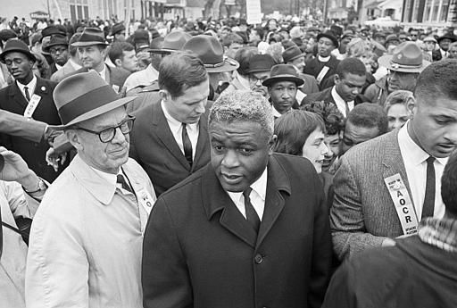 "<div class=""meta ""><span class=""caption-text "">Former baseball star Jackie Robinson, center, joined 10,000 other demonstrators in a march on the capitol in Frankfort, Ky., March 5, 1964. Robinson joined Rev. Martin Luther King in speechmaking following the march. (AP Photo) (AP Photo/ Anonymous)</span></div>"