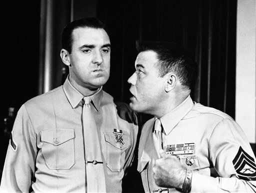 "<div class=""meta ""><span class=""caption-text "">Jim Nabors, left., and Frank Sutton, in  the TV series ""Gomer Pyle -USMC"" in character in April 1964. (AP Photo) (AP Photo/ R4, N    XCJ)</span></div>"