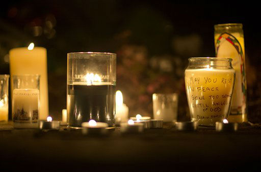 "<div class=""meta ""><span class=""caption-text "">A message is seen on a candle outside the St. Rose of Lima Roman Catholic Church, Saturday, Dec. 15, 2012, in Newtown, Conn. A man killed his mother at their home and then opened fire Friday inside the Sandy Hook Elementary school, massacring 26 people, including 20 children, as youngsters cowered in fear to the sound of gunshots reverberating through the building and screams echoing over the intercom. (AP Photo/David Goldman) (AP Photo/ David Goldman)</span></div>"