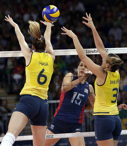 Brazil&#39;s Thaisa Menezes, left, and Danielle Lins block the spike of United States&#39; Logan Tom during the women&#39;s gold medal volleyball match at the 2012 Summer Olympics, Saturday, Aug. 11, 2012, in London. &#40;AP Photo&#47;Dave Martin&#41; <span class=meta>(AP Photo&#47; Dave Martin)</span>