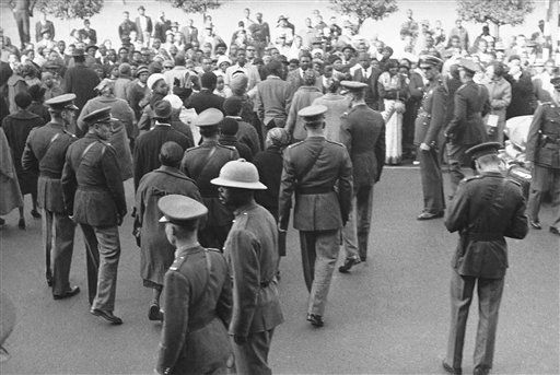 "<div class=""meta ""><span class=""caption-text "">Police clear away Africans from the area of the court in Pretoria, South Africa, after a verdict of guilty was pronounced on defendants in the South African treason trial on June 11, 1964. African nationalist leaders Nelson Mandela and Walter Sisulu were found guilty on all four counts, as were four other African defendants. Dennis Molberg, a white civil engineer, was found guilty on all counts, but the two other white defendants were found not guilty and discharged. The only Indian defendant was found guilty on the sabotage count only. All seven found guilty were sentenced to life imprisonment. (AP Photo) (AP Photo/ Anonymous)</span></div>"