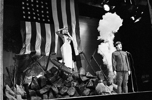 The big tear-jerker of the TV burlesque show, in contrast to the comedy and striptease, is Jim Nabors, in character on Dec. 17, 1964, singing of &#34;The Rose That Grows in Noman&#39;s Land,&#34; with a Red Cross nurse saluting amid battlefield rubble and bomb bursts.  &#40;AP Photo&#47;David F. Smith&#41; <span class=meta>(AP Photo&#47; David F. Smith)</span>