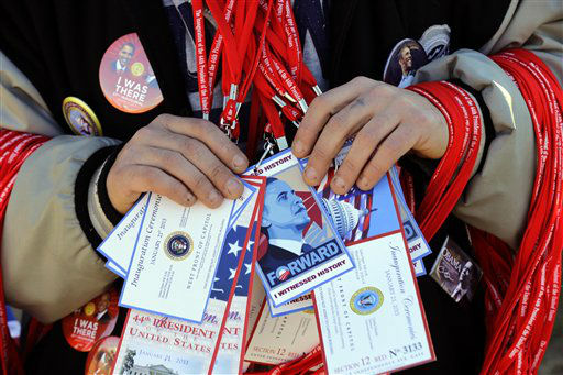 "<div class=""meta ""><span class=""caption-text "">A vendor holds items for sale on the National Mall with the U.S. Capitol prepared for the ceremonial swearing-in of President Barack Obama, the 57th Presidential Inaugural, Sunday, Jan. 20, 2013 in Washington. (AP Photo/Alex Brandon) (AP Photo/ Alex Brandon)</span></div>"