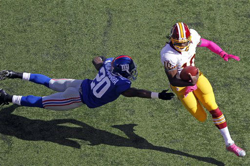 Washington Redskins quarterback Robert Griffin III &#40;10&#41; avoids a tackle by New York Giants cornerback Prince Amukamara &#40;20&#41; during the first half of an NFL football game Sunday, Oct. 21, 2012 in East Rutherford, N.J. &#40;AP Photo&#47;Julio Cortez&#41; <span class=meta>(AP Photo&#47; Julio Cortez)</span>