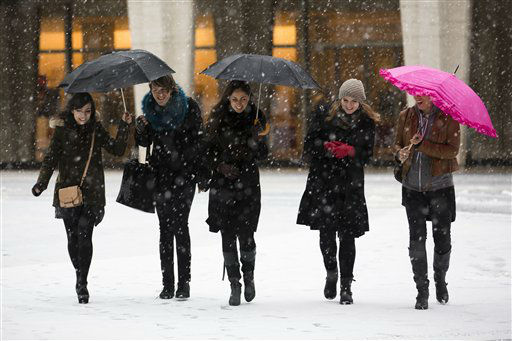 "<div class=""meta ""><span class=""caption-text "">Pedestrians walk through the snow at Lincoln Center during Fashion Week, Friday, Feb. 8, 2013, in New York. Snow began falling across the Northeast on Friday, ushering in what was predicted to be a huge, possibly historic blizzard and sending residents scurrying to stock up on food and gas up their cars. (AP Photo/John Minchillo) (AP Photo/ John Minchillo)</span></div>"
