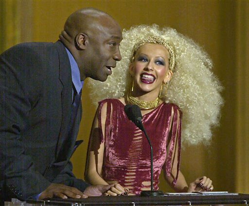 FILE - In this Tuesday, April 10, 2001 file photo, pop singer Christina Aguilera accepts her award for favorite female artist of the year from presenter Michael Clarke Duncan at the Seventh Annual Blockbuster Awards in Los Angeles.  Duncan has died at the age of 54 on Monday, Sept. 3, 2012 in a Los Angeles hospital after nearly two months of treatment following a July 13, 2012 heart attack, his fiancee, the Rev. Omarosa Manigault, said. &#40;AP Photo&#47;Michael Caulfield&#41; <span class=meta>(AP Photo&#47; Michael Caulfield)</span>