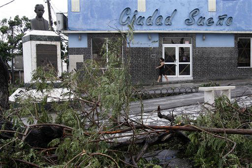 "<div class=""meta ""><span class=""caption-text "">Fallen trees lie on the street after the passing of Hurricane Sandy in Santiago de Cuba, Cuba, Thursday Oct. 25, 2012.  Hurricane Sandy blasted across eastern Cuba on Thursday as a potent Category 2 storm and headed for the Bahamas after causing at least two deaths in the Caribbean. (AP Photo/Franklin Reyes) (AP Photo/ Franklin Reyes)</span></div>"