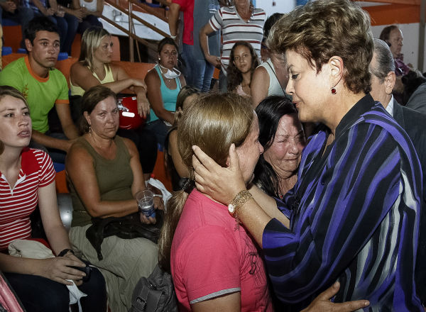 Brazil&#39;s President Dilma Rousseff comforts victim&#39;s relatives in Santa Maria, southern Brazil, Sunday, Jan. 27, 2013.  Rousseff cut short a visit to Chile early Sunday to go to Santa Maria after a deadly nightclub fire. Flames raced through a crowded nightclub in southern Brazil early Sunday, killing more than 200 people as panicked party-goers stampeded toward the exits and gasped for air in the smoke-filled space, authorities said. It appeared to be the world&#39;s deadliest nightclub fire in more than a decade. &#40;AP Photo&#47;Roberto Stuckert Filho&#47;Brazil&#39;s Presidency&#41; <span class=meta>(AP Photo&#47; Roberto Stuckert)</span>