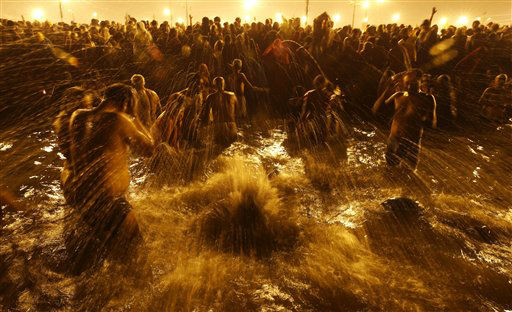 Hindu devotees take ritual dips at &#39;Sangam&#39;, confluence of Hindu holy rivers of Ganges, Yamuna and the mythical Saraswati, on the third and last royal bath of the Maha Kumbh festival on occasion of &#39;Basant Panchami&#39; in Allahabad, India, Friday, Feb. 15, 2013. Millions of Hindu pilgrims are attending the Maha Kumbh festival, which is one of the world&#39;s largest religious gatherings that lasts 55 days and falls every 12 years. During the festival pilgrims bathe in the holy Ganges River in a ritual they believe can wash away their sins. &#40;AP Photo&#47; Saurabh Das&#41; <span class=meta>(AP Photo&#47; Saurabh Das)</span>