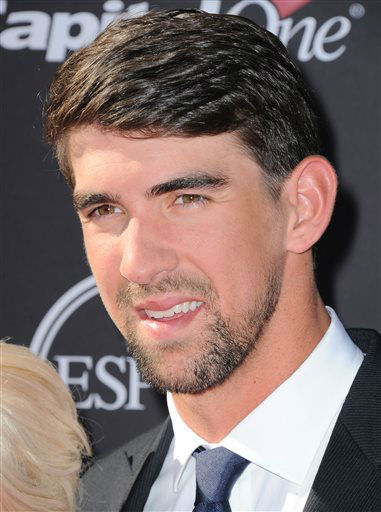 Swimmer Michael Phelps arrives at the ESPY Awards on Wednesday, July 17, 2013, at Nokia Theater in Los Angeles. &#40;Photo by Jordan Strauss&#47;Invision&#47;AP&#41; <span class=meta>(Photo&#47;Jordan Strauss)</span>